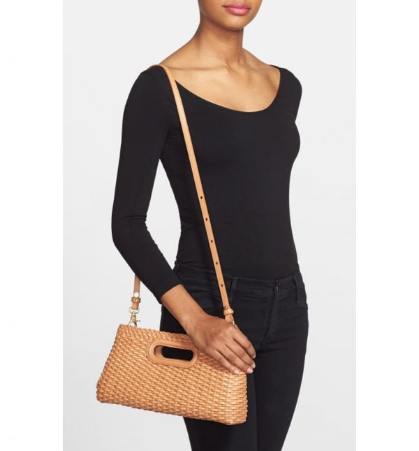 Woman Holding Brahmin Woven Leather Clutch